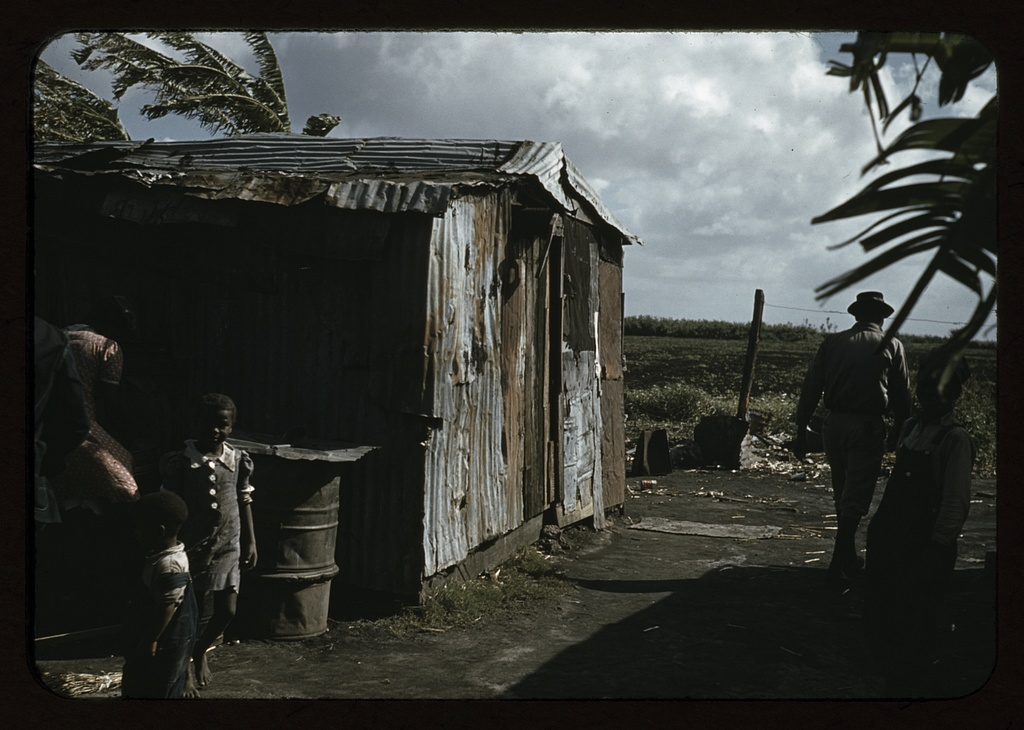 Negro migratory workers by a shack