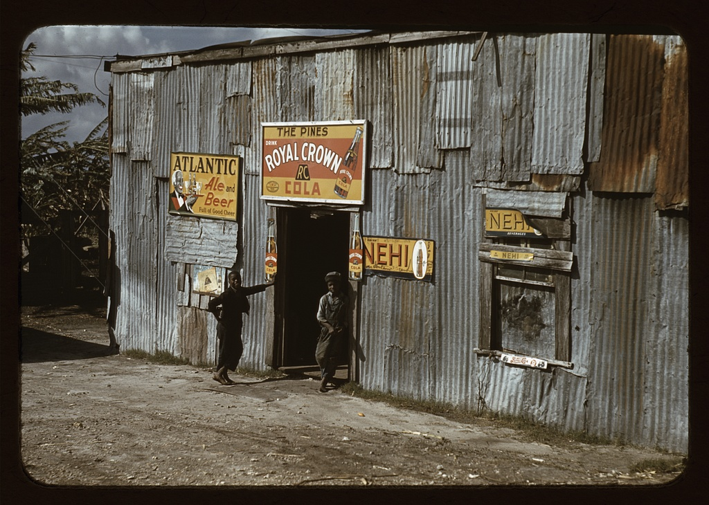 """Negro migratory workers by a """"juke joint"""""""